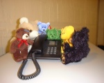 Kerry, Nikster, Annabelle, Domain Key, Jasper and Albert using a phone at InternetNZ.