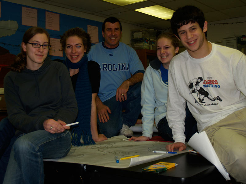 Chapel Hill High School science teacher Rob Greenberg, center, guides students (left to right) Jess Hitt, Natalie Archer, Louisa Sloan and Andrew Hertzberg through their project for the Celebration of Earth and Sky this Sunday at Carrboro Century Center. Photo by Valarie Schwartz.