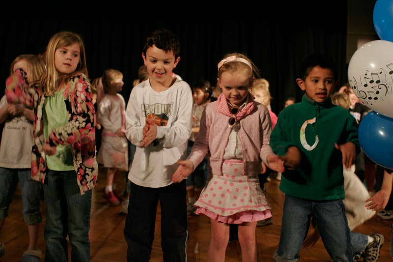 Carrboro Elementary School students dance at a '50s sock hop to