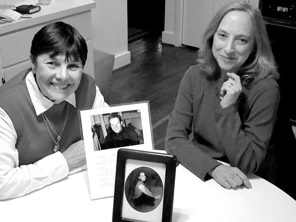 Julie Coleman, left, sits with Daphne Hill and pictures of their children. The two founded the Chapel Hill chapter of The Compassionate Friends, which helps parents cope with losing a child. Photo by Emily Burns.