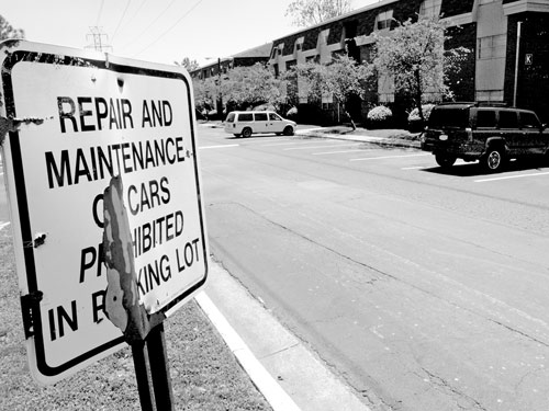 Abbey Court has had a long standing policy against repair and maintenance of vehicles in its parking lot. Photo by Jordan Timpy.
