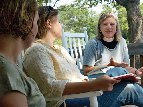 Reverend Lisa Fischbeck, right, discusses passages from the Bible with Alane Kasrawi, far left, and Lauren Kilbourn Gaudett at a relaxed service at The Episcopal Church of the Advocate on Weaver Street Wednesday morning. Photo by Jordan Timpy.