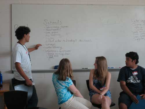 "PHOTO BY KATE GRISMANN. Chapel Hill Youth Council member Daniel Woldorff leads a discussion about improving environmentalism in area schools as part of the CHYC's youth summit ""Speak up! Speak out!"""