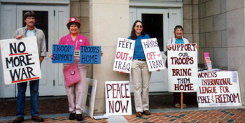 Left to right, Jim Igoe, Ann Powers, Jennifer Lewis and Lori Hoyt, following in the long history of WILPF at the Peace and Justice Plaza in Chapel Hill  Photo courtesy of Lucy Lewis