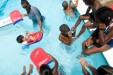 PHOTO BY BARBARA TYROLER. Community children learn to swim in the Hargraves Community Center's summer camp swimming program.