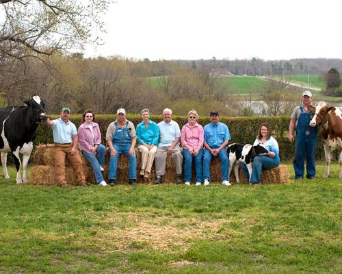 the extended maple view farm family poses for a photo on the farm in ...