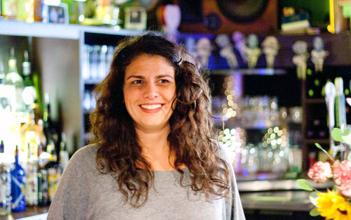 Tricia Mesigian, behind the bar at Orange County Social Club, Carrboro's favorite hostess.  Photo by Alicia Stemper