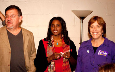 Elected Carrboro Board of Aldermen members Dan Coleman, Michelle Johnson and Lydia Lavelle prepare to thank supporters at their election night gathering at Open Eye Cafe. Photo by Alicia Stemper