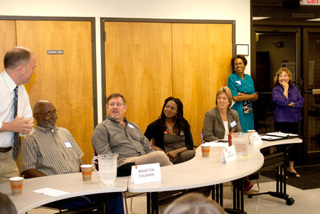 Renee Price and Mary Bushnell (right) enjoy a light-hearted moment with Mayor Mark Chilton and the candidates for the Carrboro Boardof Aldermen at a forum hosted by the Orange County Democratic Women earlier this election season. Photo by Alicia Stemper