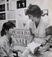 In this 1985 photograph for the Chancellor's Report, Doris Betts works with a creative writing student at the Carolina Quarterly.  Photo by Jock Lauterer