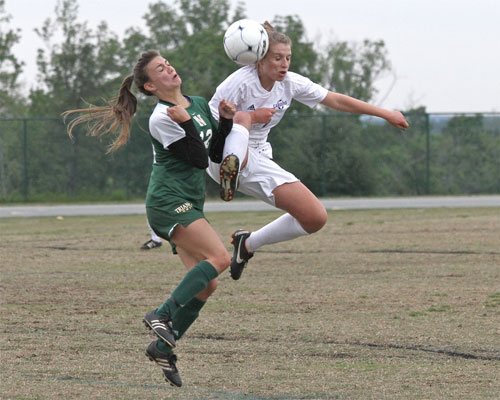 Carrboro's Kylie Tawney goes airborne to control the ball.