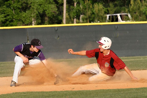 Carrboro's Jeff Strongoli applies a tag as a Cedar Ridge player slides into second base. Carrboro High baseball fell to Cedar Ridge, 10-4, on Tuesday. Carrboro (10-5 overall, 6-3 league) is in fourth place in league play and is still in position to make the playoffs. Photo by Ted Spaulding.