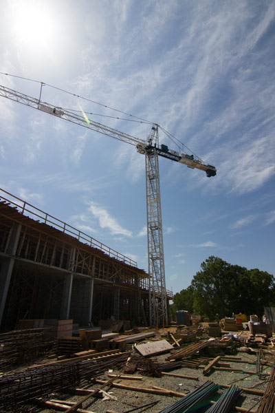 Construction on 300 East Main is progressing on schedule following the March groundbreaking. The crane will likely remain on the site through September.  Photo by Alicia Stemper