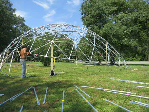 Carrboro resident John Quick deconstructs the geodesic dome he and a few friends constructed to transport out to Nevada's Black Rock Desert for Burning Man, where it will serve as a temporary venue of sorts. PHOTO BY JAMIE DEGRAW