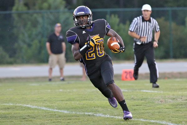 Carrboro's Trai Sharp flies down the field on a kickoff return.