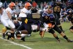 Carrboro defenders Ezavian Dunn (#78) and James Scott (#44) take down an Orange player.