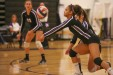 Olivia Meyer-Massey digs out an offensive volley by Northwood.