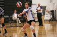 Carrboro defensive specialist Anna Broome sets the ball for her teammates.