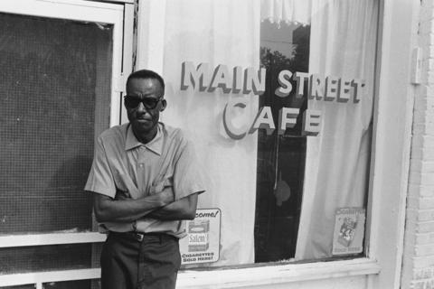 "James ""Son"" Thomas in front of cafe"