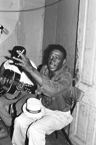 Gussie Tobe playing guitar