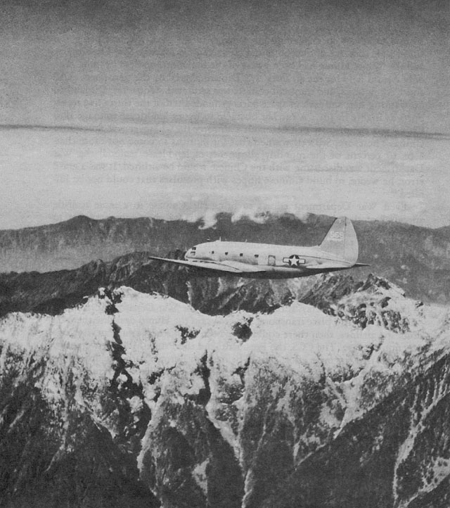 1944, a C-46 transport plane flying over the Hump.