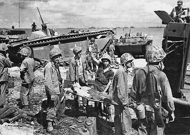 the marine assault on tinian essay Battle of tinian from wikimedia marine assault troops wade ashore on tinian island marines land on tinian island in the face of light japanese opposition.