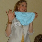 Dana displays an item in the division's silent auction in Toronto, 2005. (From Chris Hardesty)